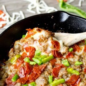 Skillet pizza potatoes with a wooden spoon - skillet meals