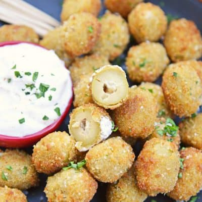 Fried Blue Cheese Stuffed Olives will become your favorite New Year's Eve recipe. But, this easy appetizer recipe is perfect for all occasions! #newyearseverecipes #easyappetizerrecipes #oliverecipes www.savoryexperiments.com
