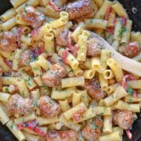 This delicious One-Pan Sausage Alfredo Pasta is an easy weeknight meal with instructions on how to make homemade alfredo sauce. So simple and good! #alfredosauce #alfredopasta www.savoryexperiments.com
