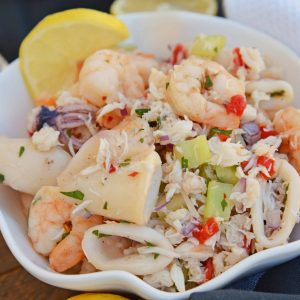 This Italian Seafood Salad, made with shrimp, calamari and lump crab meat, is one of the best and easiest seafood salad recipes you'll ever try. #seafoodsalad #italianseafoodsalad www.savoryexperiments.com