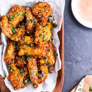 firecracker chicken wings on a platter