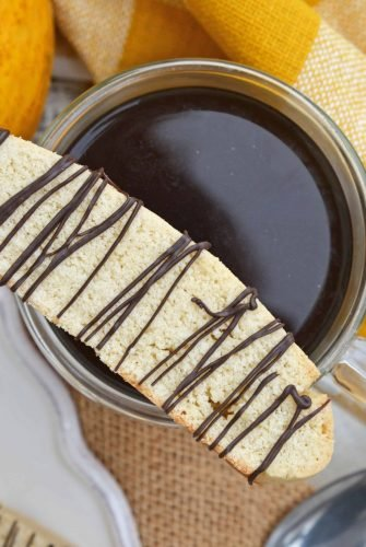 Vanilla Mocha Biscotti are easy to make and perfect for pairing with coffee or tea. Subtle coffee, vanilla and chocolate flavors make them suitable for any occasion. #homemadebiscotti #biscottirecipe www.savoryexperiments.com