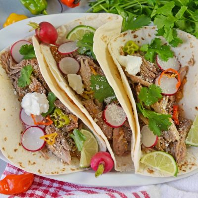 Pressure Cooker Carnitas are an easy pressure cooker recipe for shredded pork with Mexican flavors. Perfect for making the perfect soft taco! #pressurecookercarnitas #instantpotcarnitas #easycarnitas www.savoryexperiments.com
