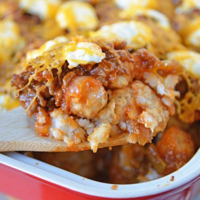 Sloppy Joe Tater Tot Casserole combines layers of crispy tater tots with homemade sloppy Joe mix, cream cheese and cheddar for the ultimate quick meal or party food!#tatertotcasserole #sloppyjoes www.savoryexperiments.com