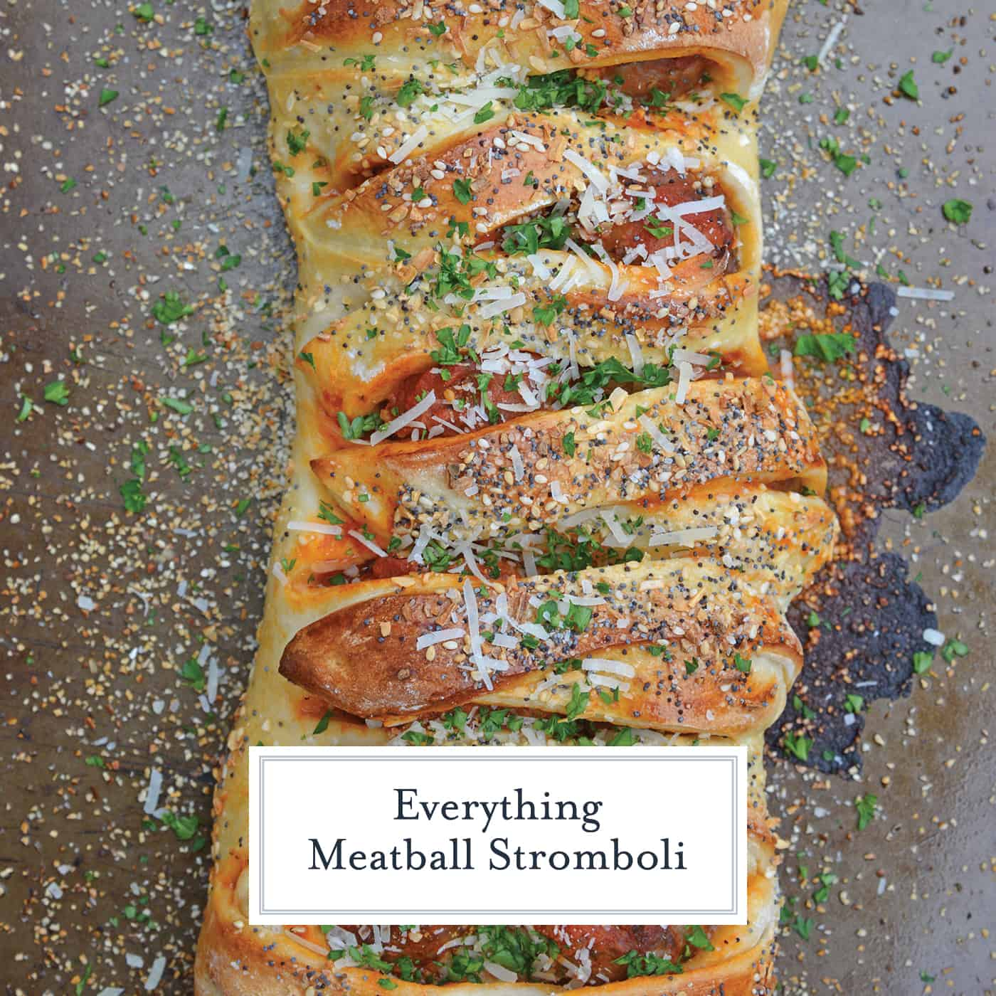Everything Meatball Stromboli is meatballs, marinara sauce and cheese wrapped in pizza dough topped with everything bagel seasoning. An easy weeknight meal recipe! #howtomakestromboli #strombolirecipe #meatballstromboli www.savoryexperiments.com