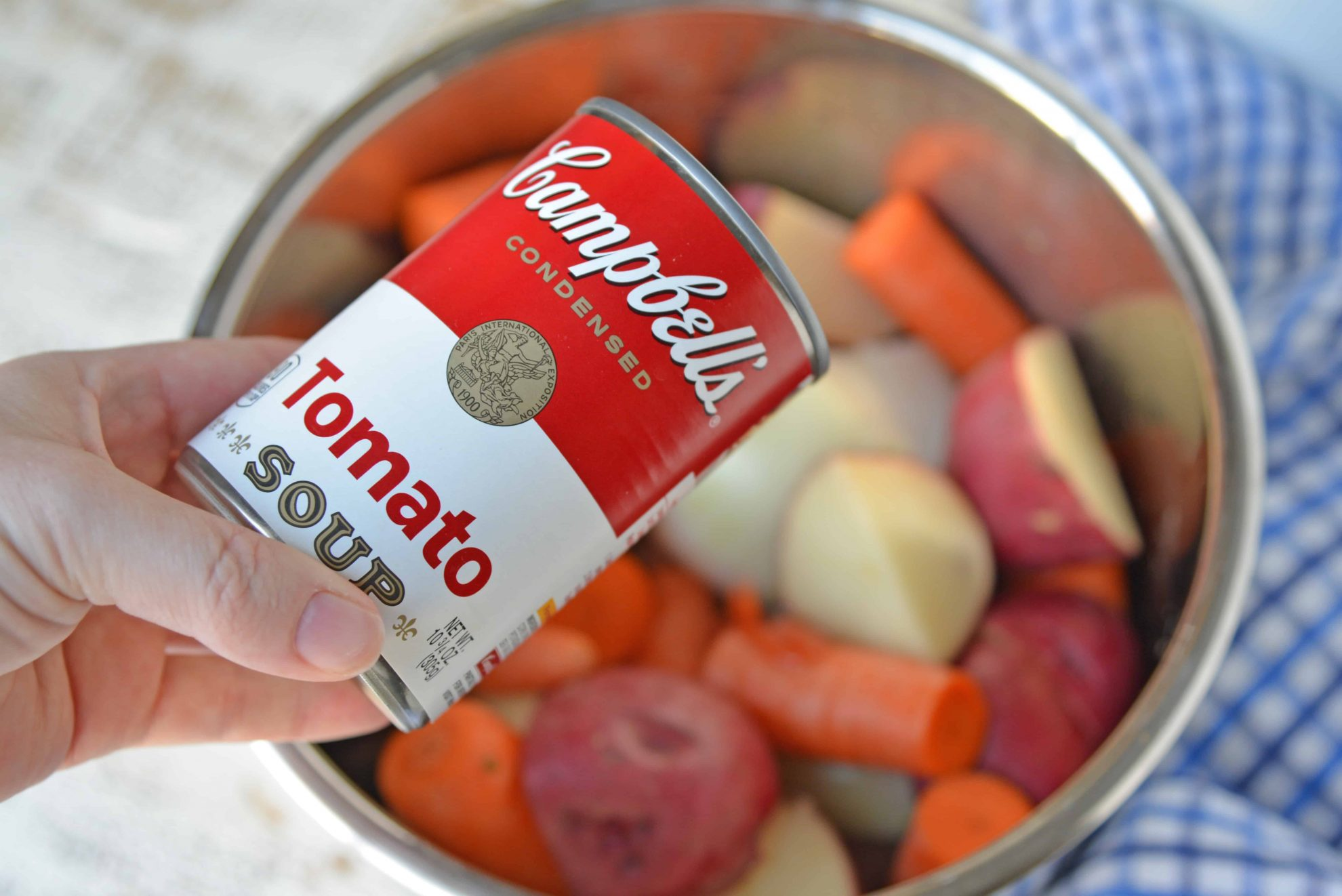 Campbell\'s Soup can pouring into pressure cooker pot