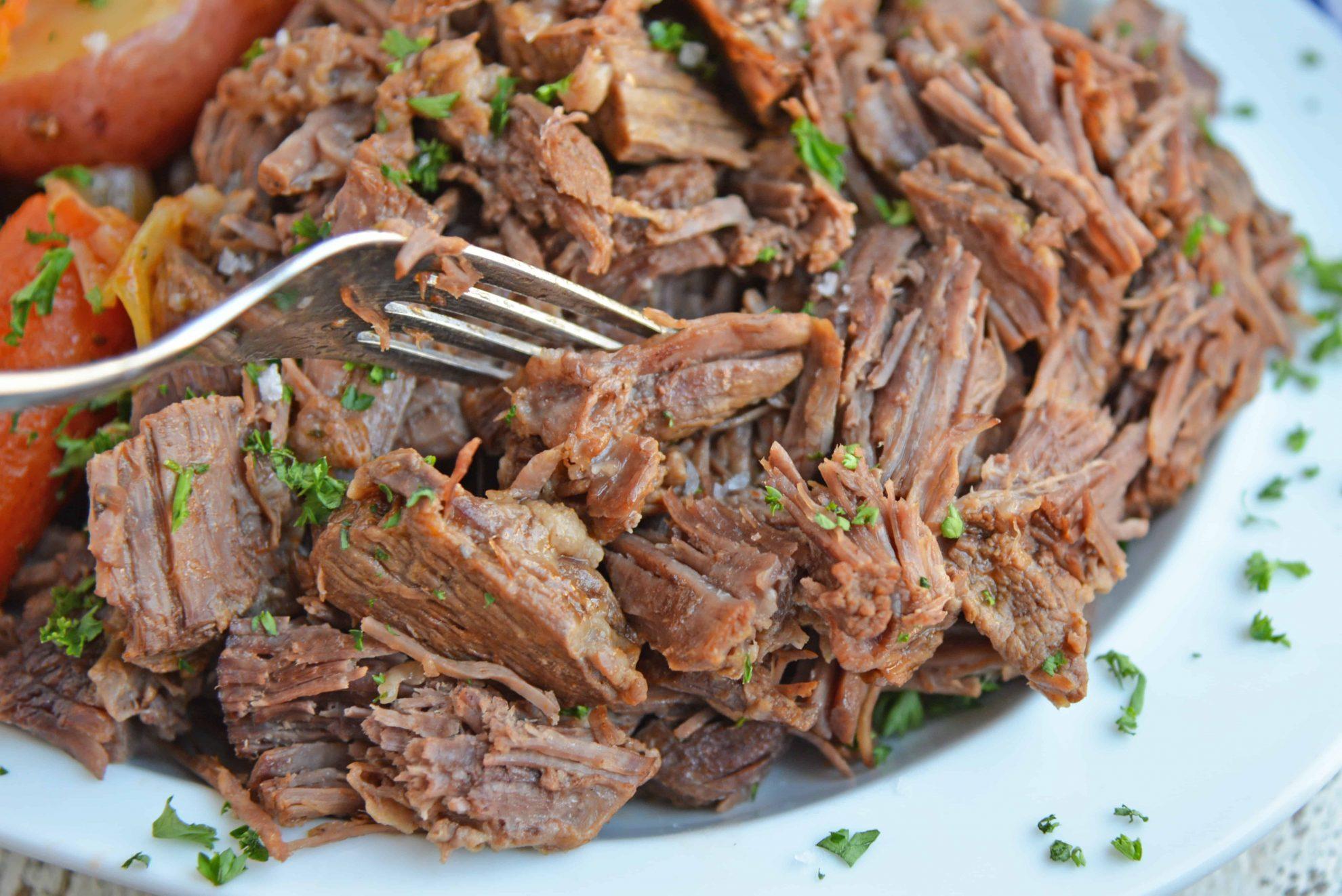 Fork shredding tender pot roast