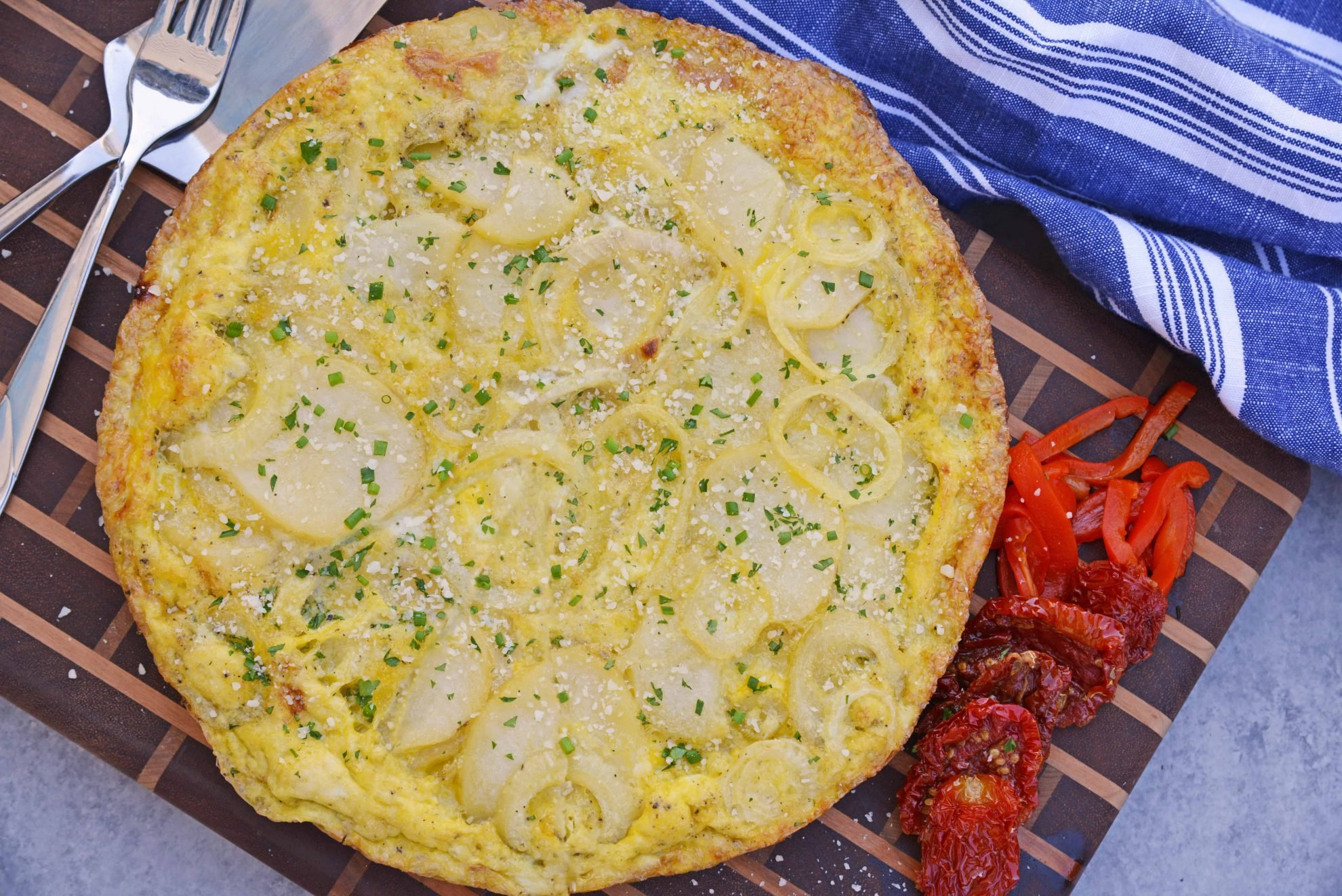 Tortilla Espanola, also known as Spanish Tortilla or Potato Tortilla, is a Spanish egg dish made with fried potatoes, onions and cheese. #tortillaespanola #spanishtortilla #potatotortilla www.savoryexperiments.com