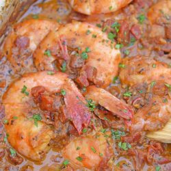 Voodoo Shrimp Creole is a tomato-based dish using shrimp and beer to make a sweet and spicy broth. Serve over rice or grits for a full meal. #voodooshrimp #shrimpcreole www.savoryexperiments.com