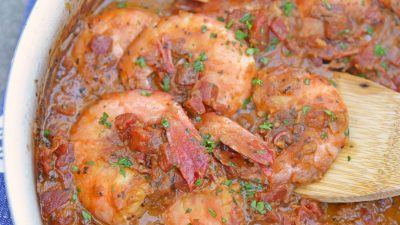 Voodoo Shrimp Creole is a tomato-based dish using shrimp and beer to make a sweet and spicy broth. Serve over rice or grits for a full meal.#voodooshrimp #shrimpcreole www.savoryexperiments.com