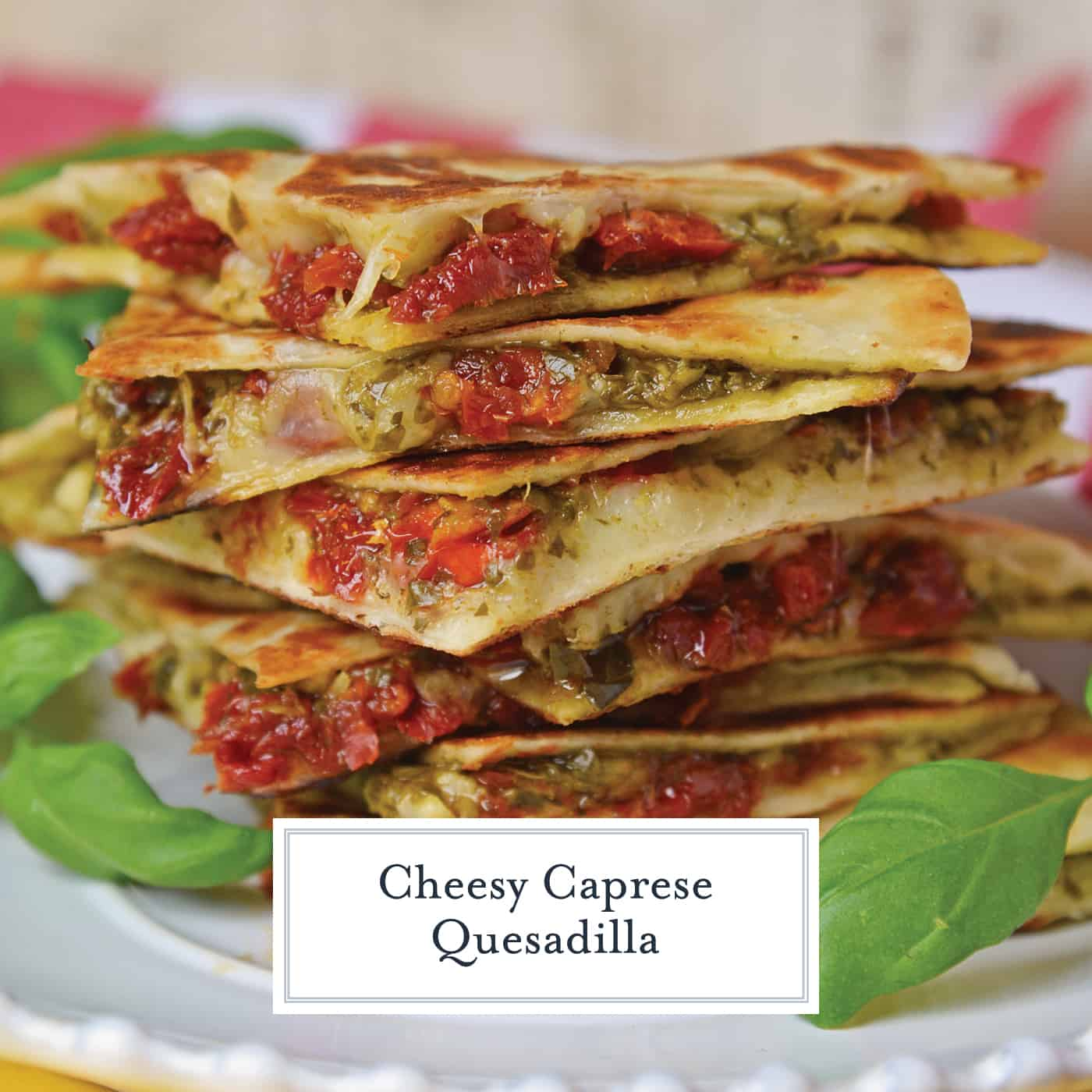 Caprese Quesadillas combine homemade pesto sauce with sun dried tomatoes and gooey mozzarella cheese. Serve for lunch, dinner or even as a party appetizer! #quesadillarecipe #capresequesadilla www.savoryexperiments.com