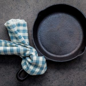 How to clean cast iron cookware in easy steps, plus how to care for and maintain cast iron to make the most of your seasoning and prevent rust!#howtocleancastiron #howtoremoverustfromcastiron www.savoryexperiments.com