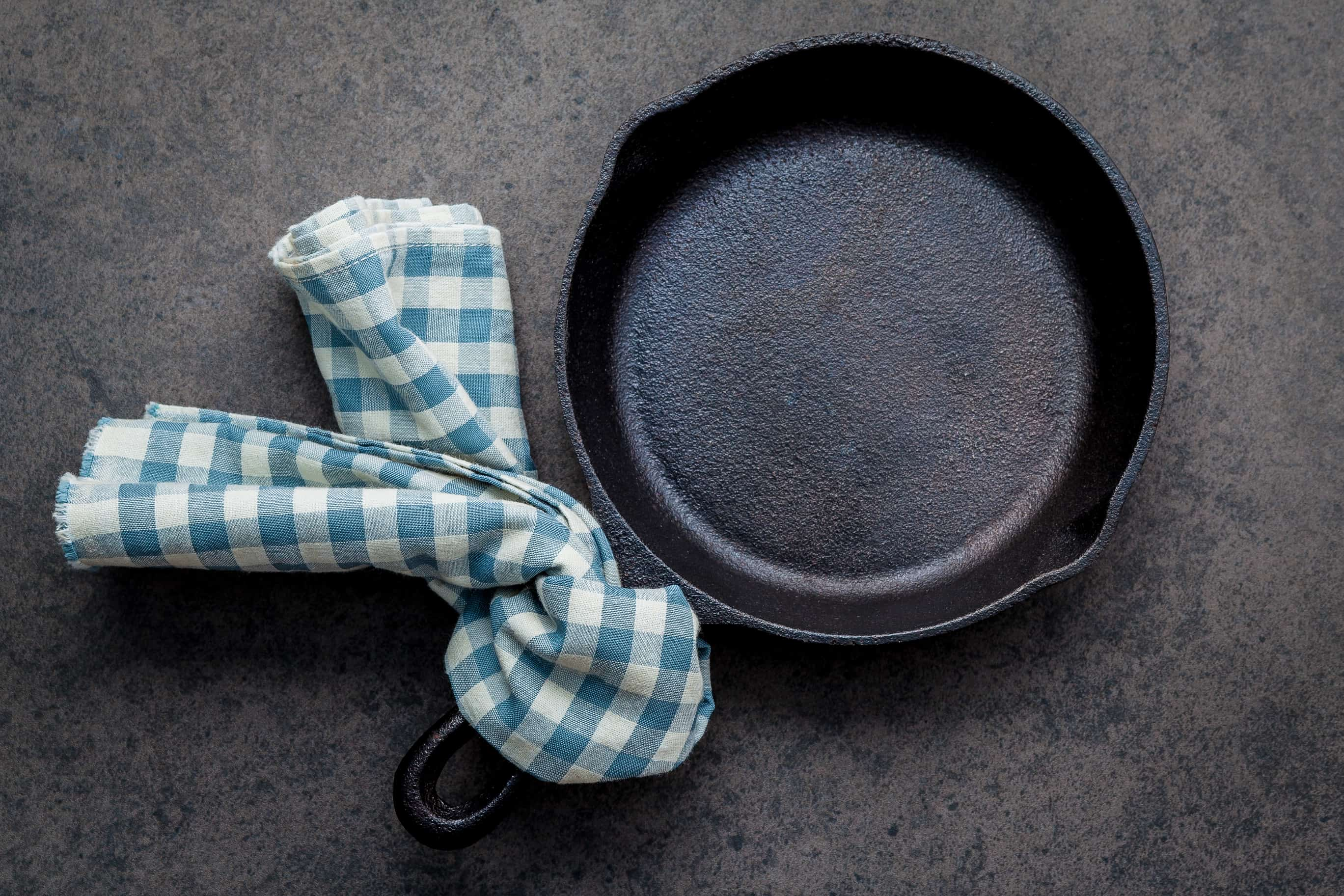 How to clean cast iron cookware in easy steps, plus how to care for and maintain cast iron to make the most of your seasoning and prevent rust! #howtocleancastiron #howtoremoverustfromcastiron www.savoryexperiments.com