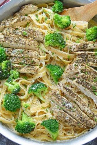 Broccoli chicken Alfredo in a stainless steel skillet
