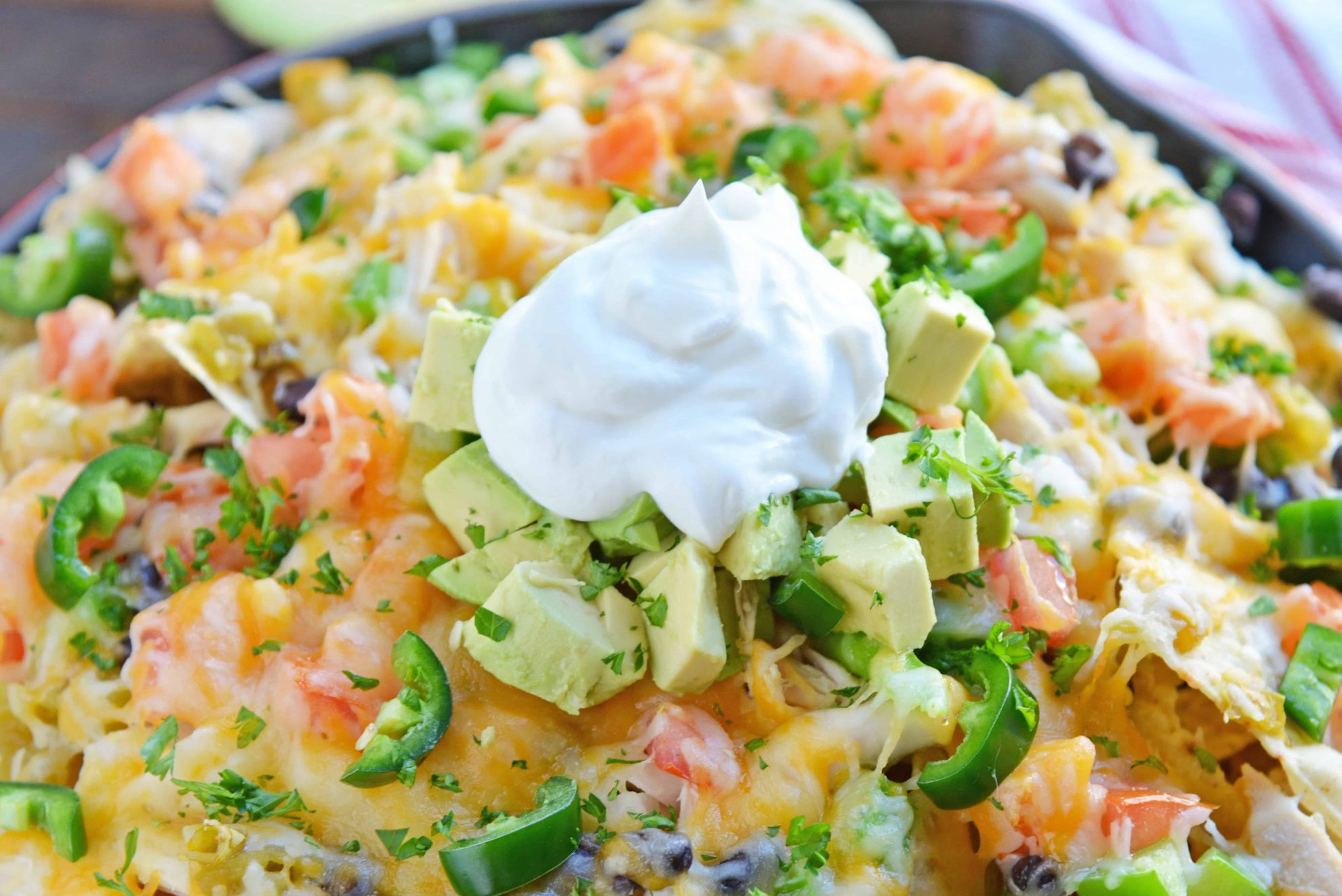 Loaded nachos with yogurt topping