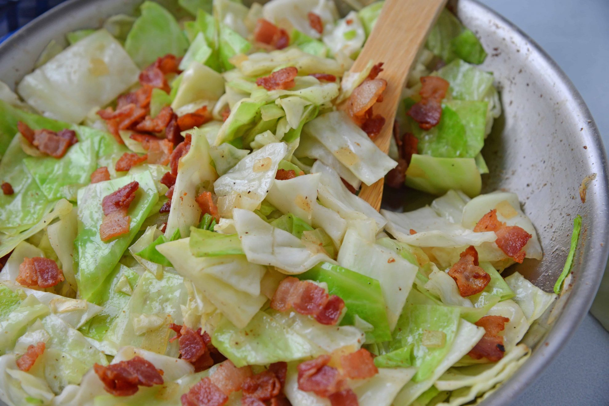 Fried Cabbage with bacon in skillet