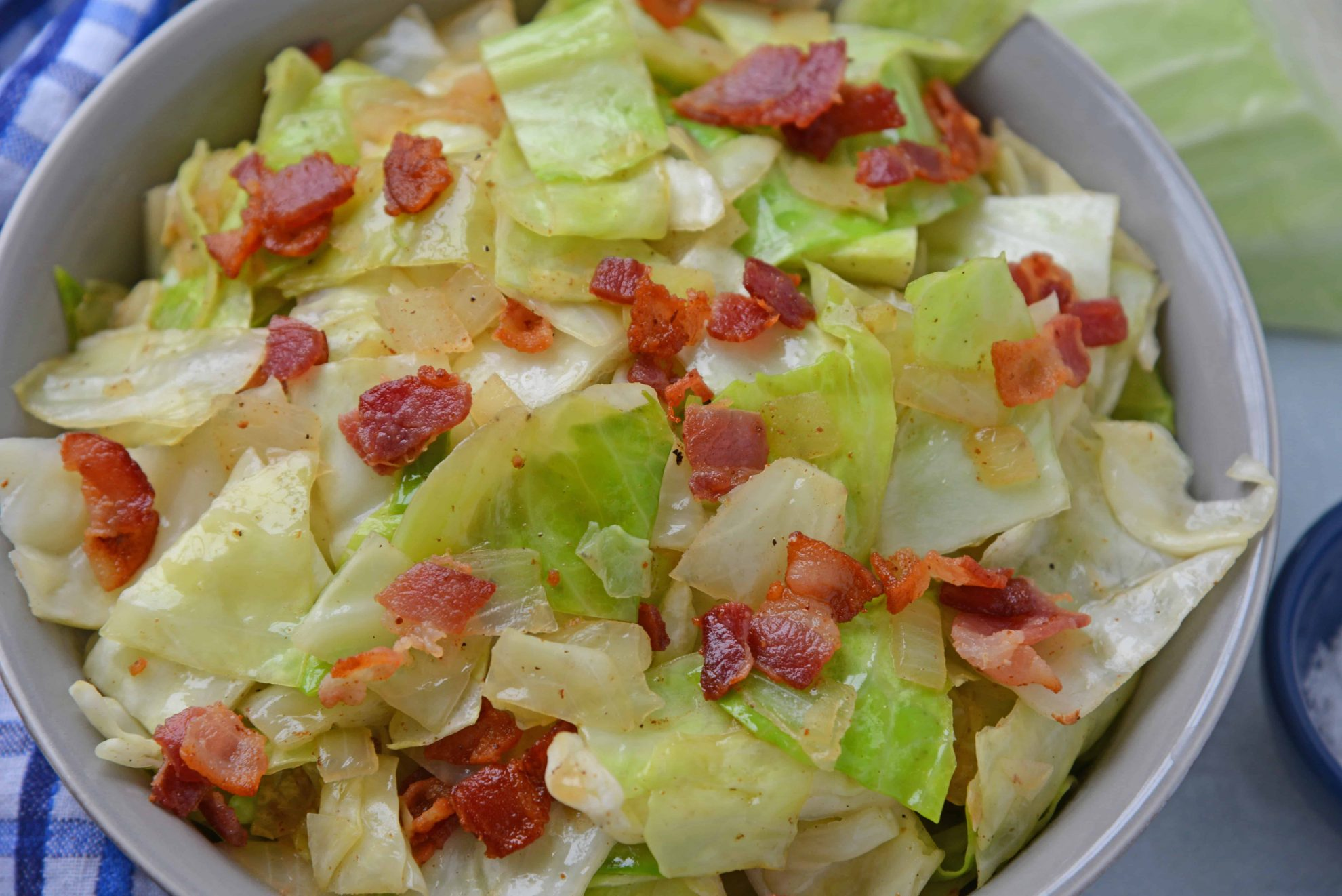 Angle of Bacon Fried Cabbage in a serving bowl