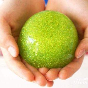 hand holding a green glitter ball