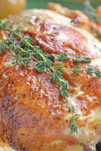 close up of roast chicken with thyme