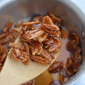 Pecan Caramel Sauce on a wooden spoon