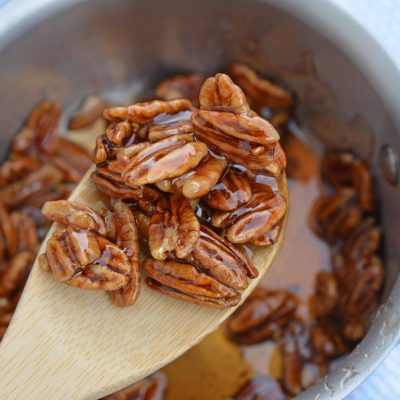 Pecan Caramel Sauce on a wooden spoon