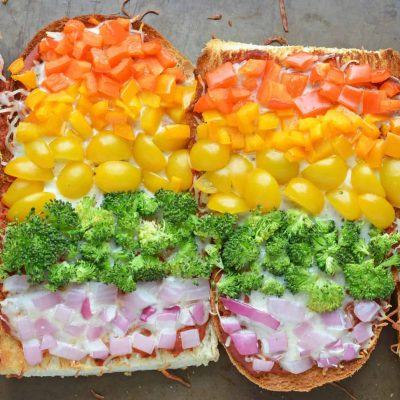 Rainbow French Bread Pizza on a Baking Sheet