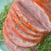 A plate of food with a slice cut out, with Ham and Thyme