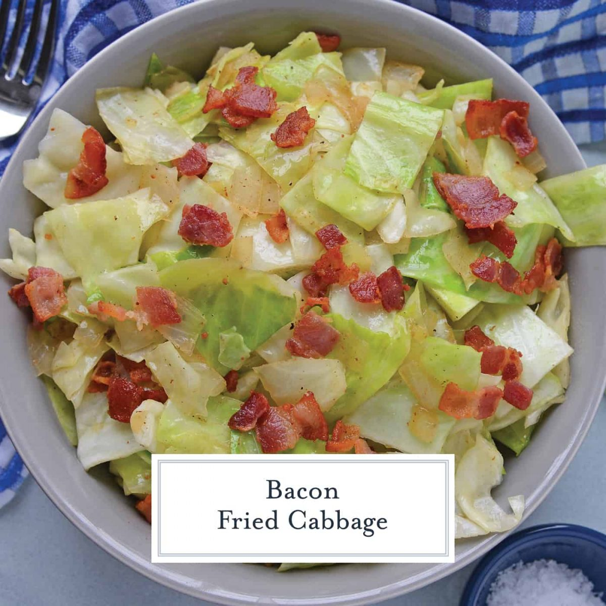 Overhead southern fried cabbage with bacon in a grey bowl