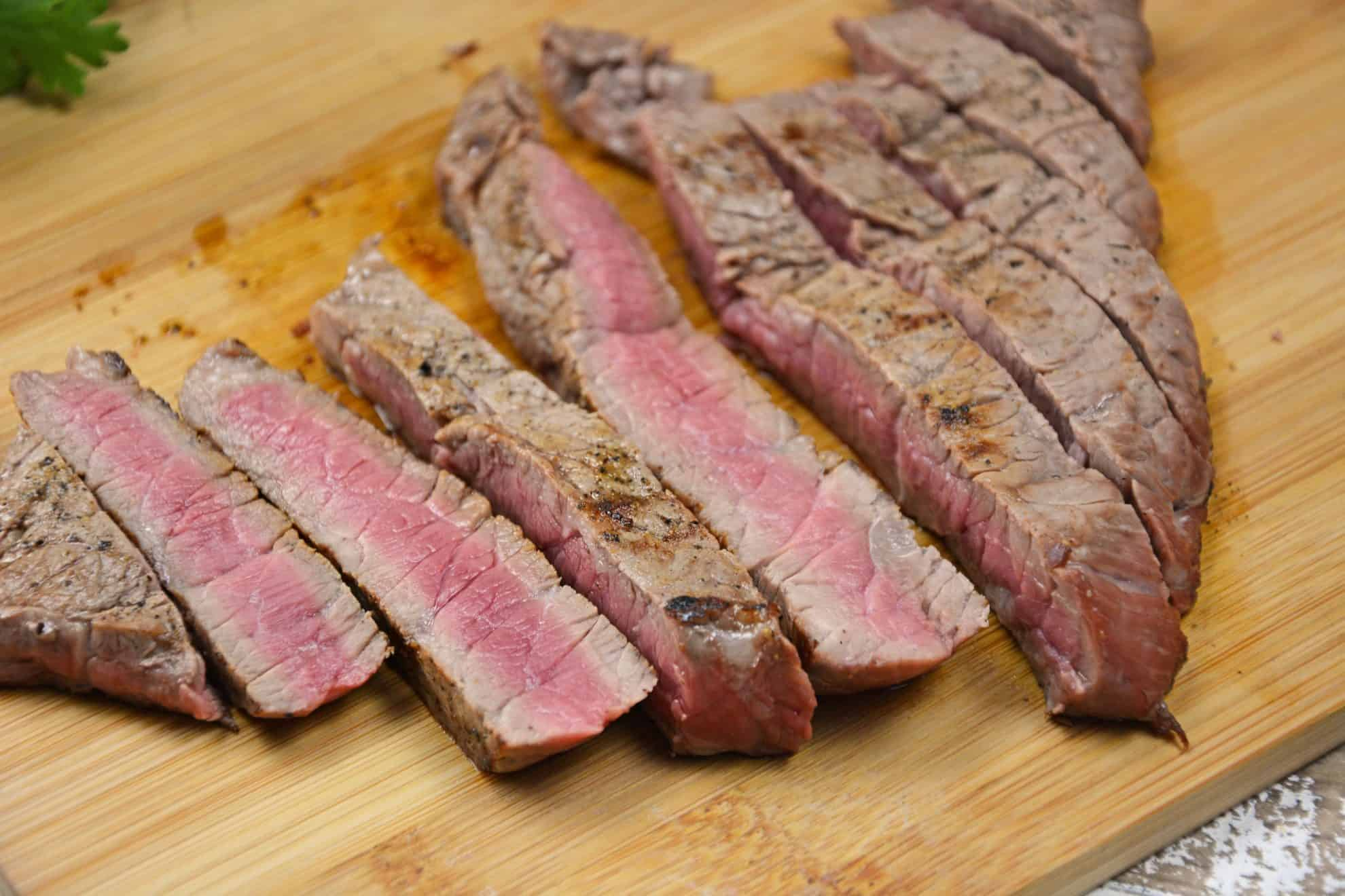 Sliced steak on a cutting board