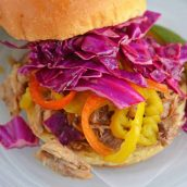 Close up of red cabbage slaw on sandwich