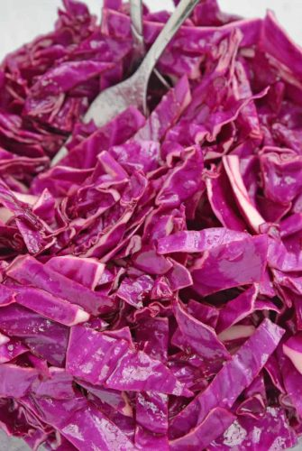 Bowl of shredded red cabbage slaw