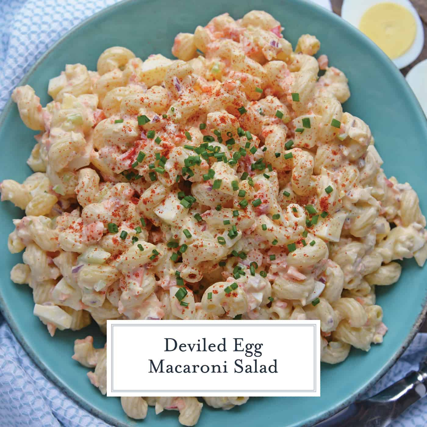 Overhead view of Deviled Egg Macaroni Salad in a blue bowl