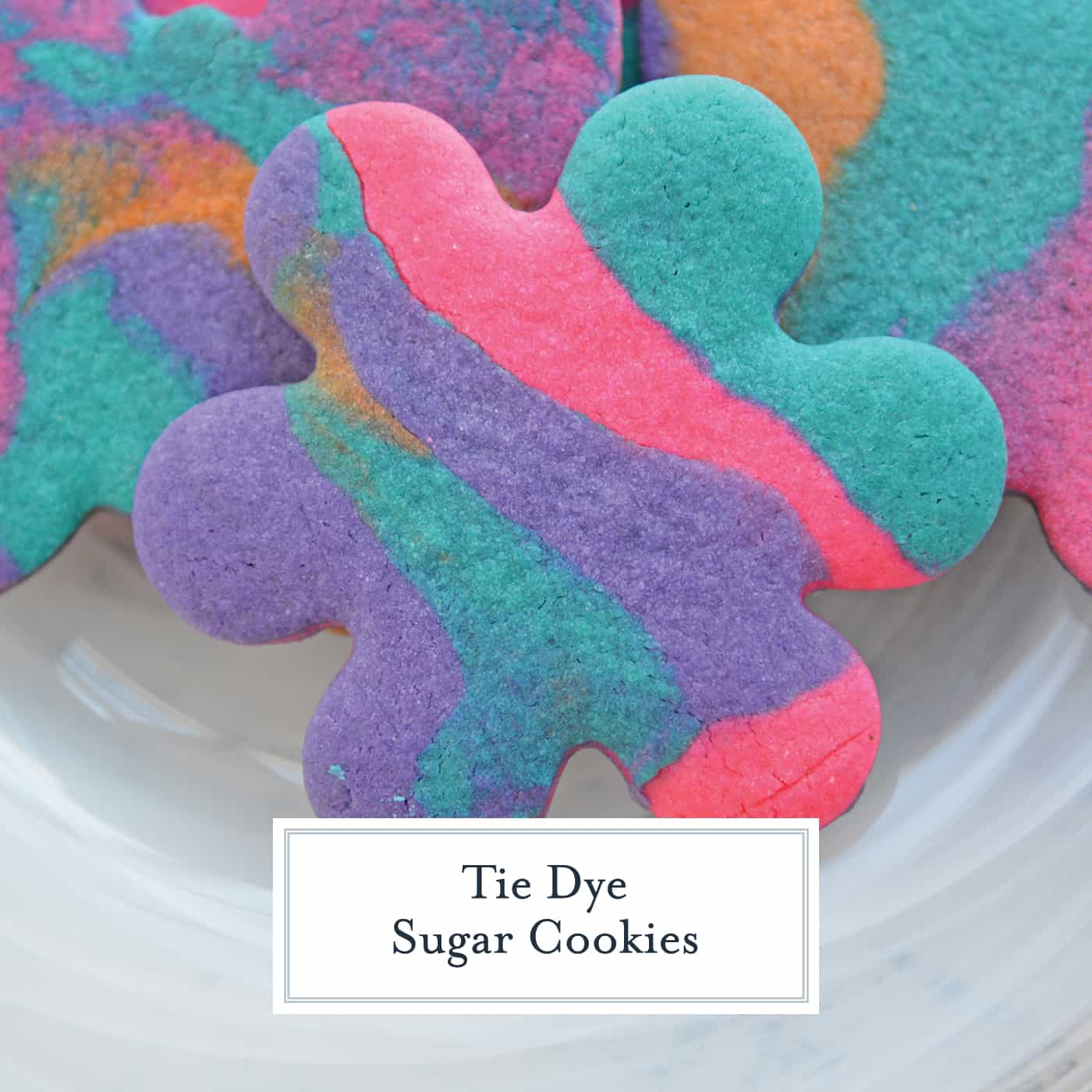 4aac47acfd6a Learn how to make these Tie Dye Sugar Cookies. Easy to make rolled sugar  cookie recipe that are already decorated straight from the oven!