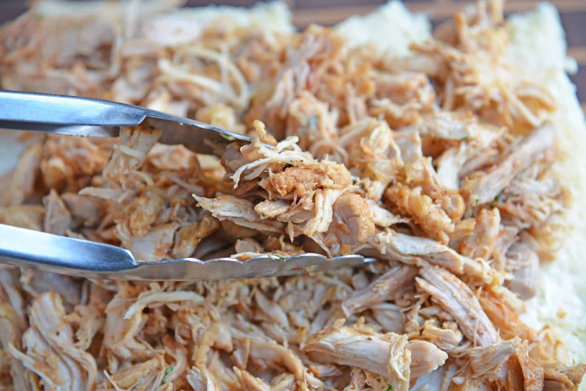 Tongs with shredded chicken
