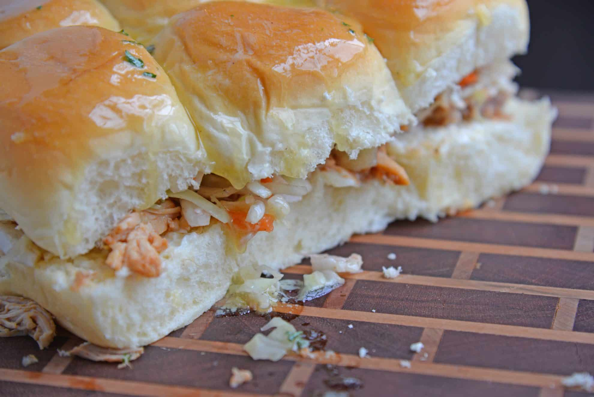 Close up of BBQ chicken sliders with slaw on a cutting board