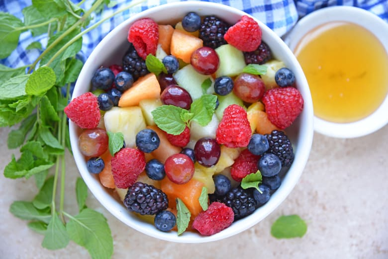 Overhead of fruit salad in white bowl