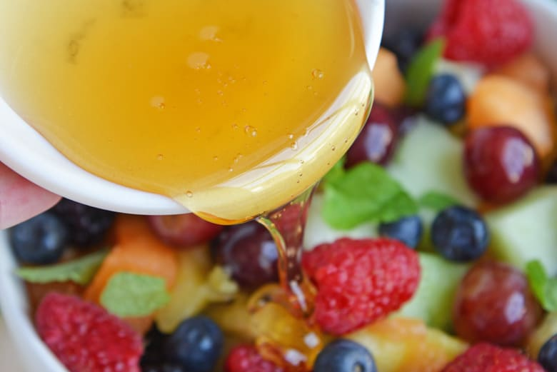 Agave nectar pouring over fruit salad