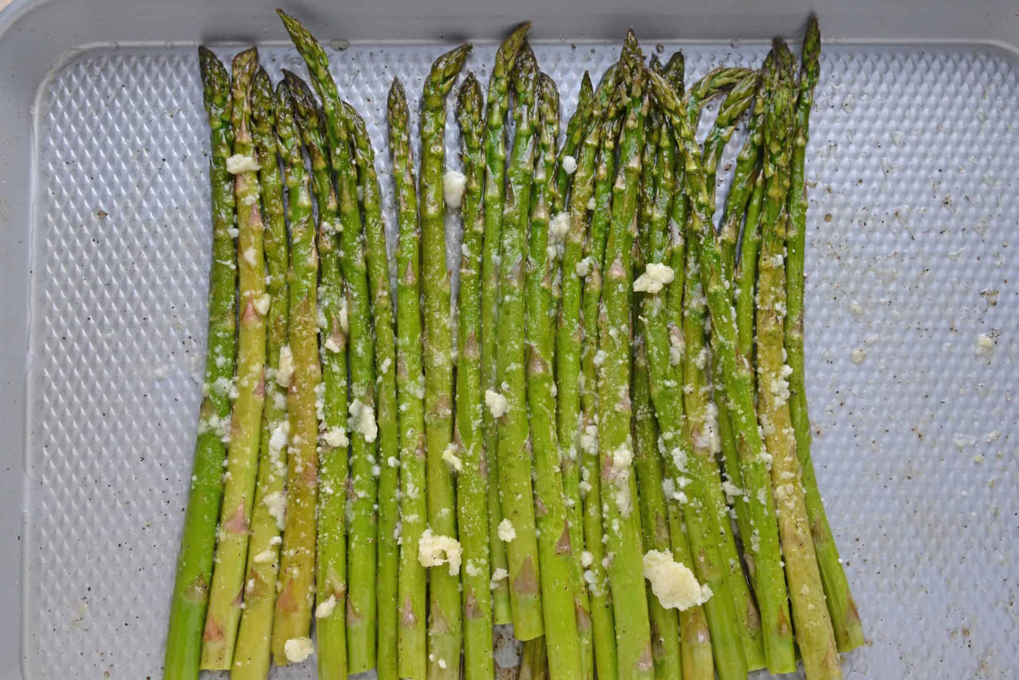 Garlic Parmesan Asparagus on a baking sheet