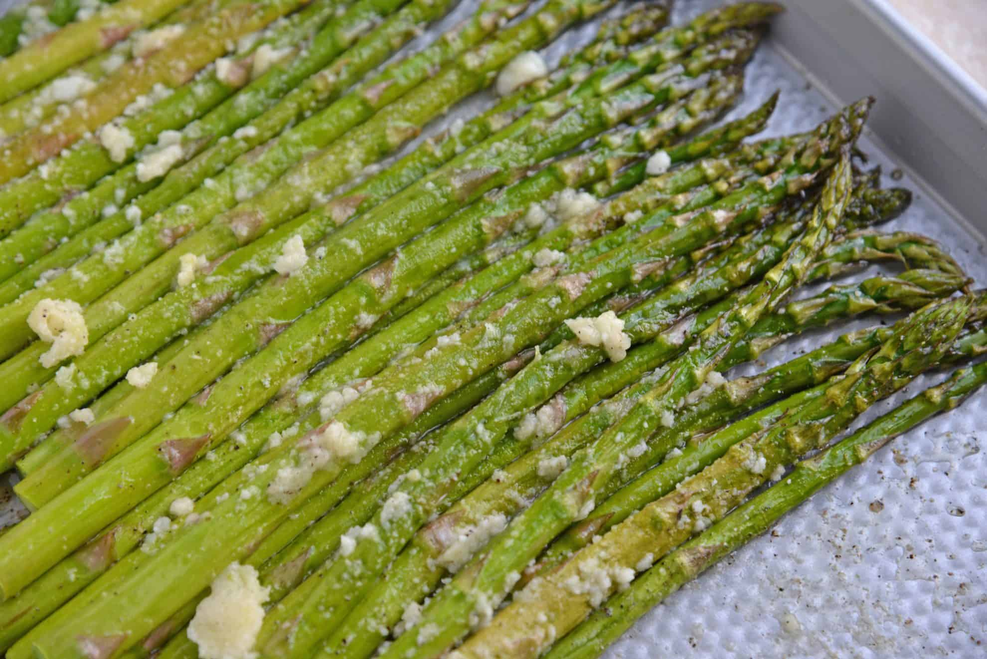 A close up of garlic parmesan asparagus
