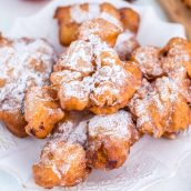 Crispy apple fritters on a white serving dish