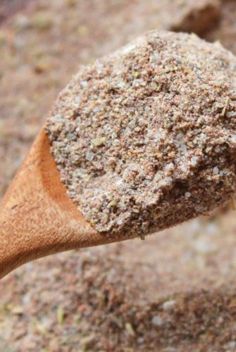 taco seasoning in a wooden spoon