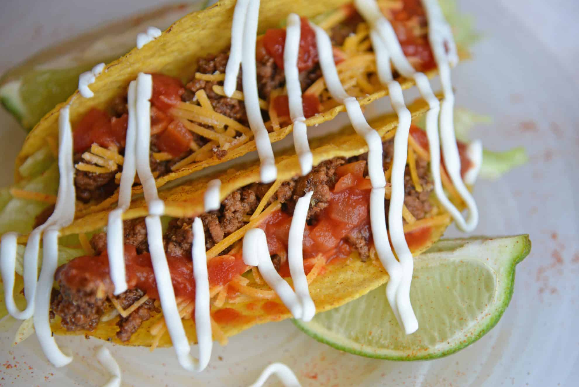 crunchy hard tacos with sour cream