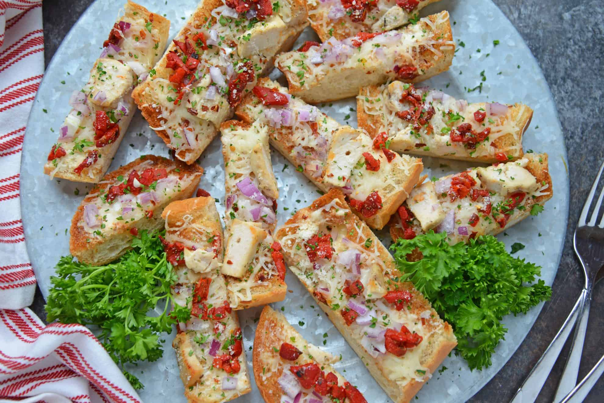 Alfredo Chicken French Bread Pizza on a serving platter