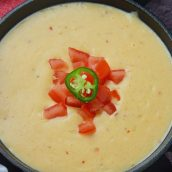 Close up of queso dip in a serving bowl
