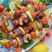 Overhead of garlic shrimp kabobs on a serving platter