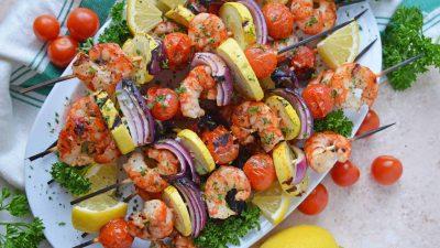 Overhead of garlic shrimp kabobs on a serving platter