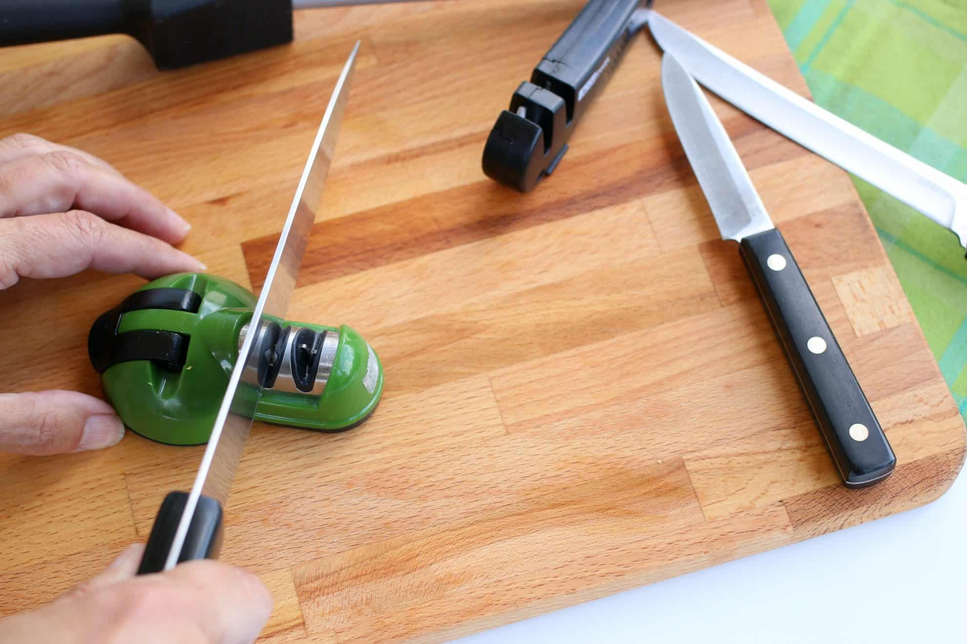Sharpening a kitchen knife using a multi-function sharpener.