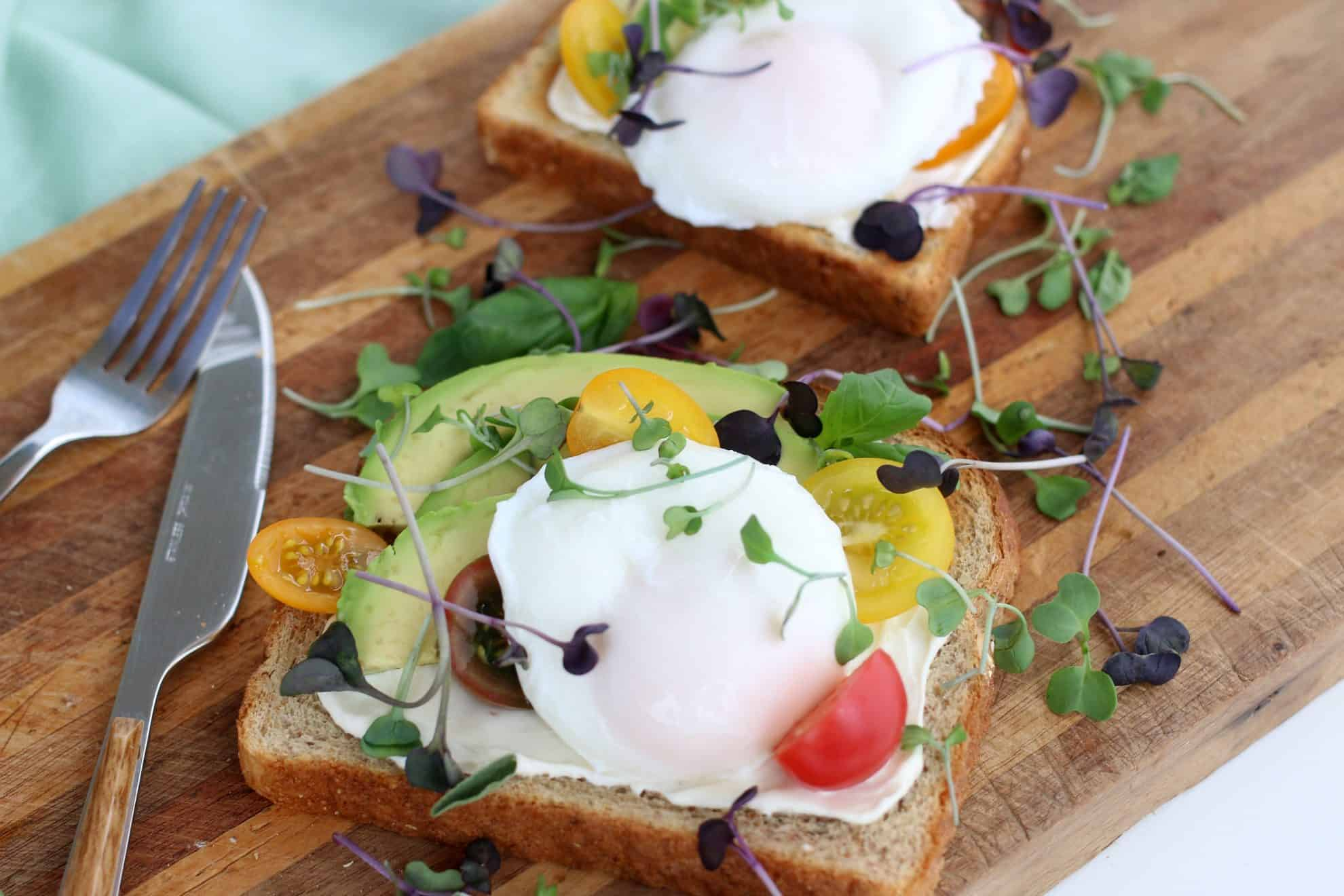 A plate of food with a knife, with Poached egg