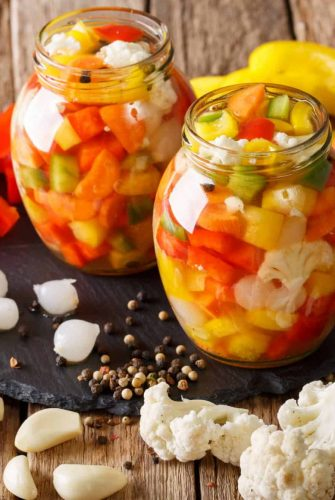 pickled vegetables on a wood counter