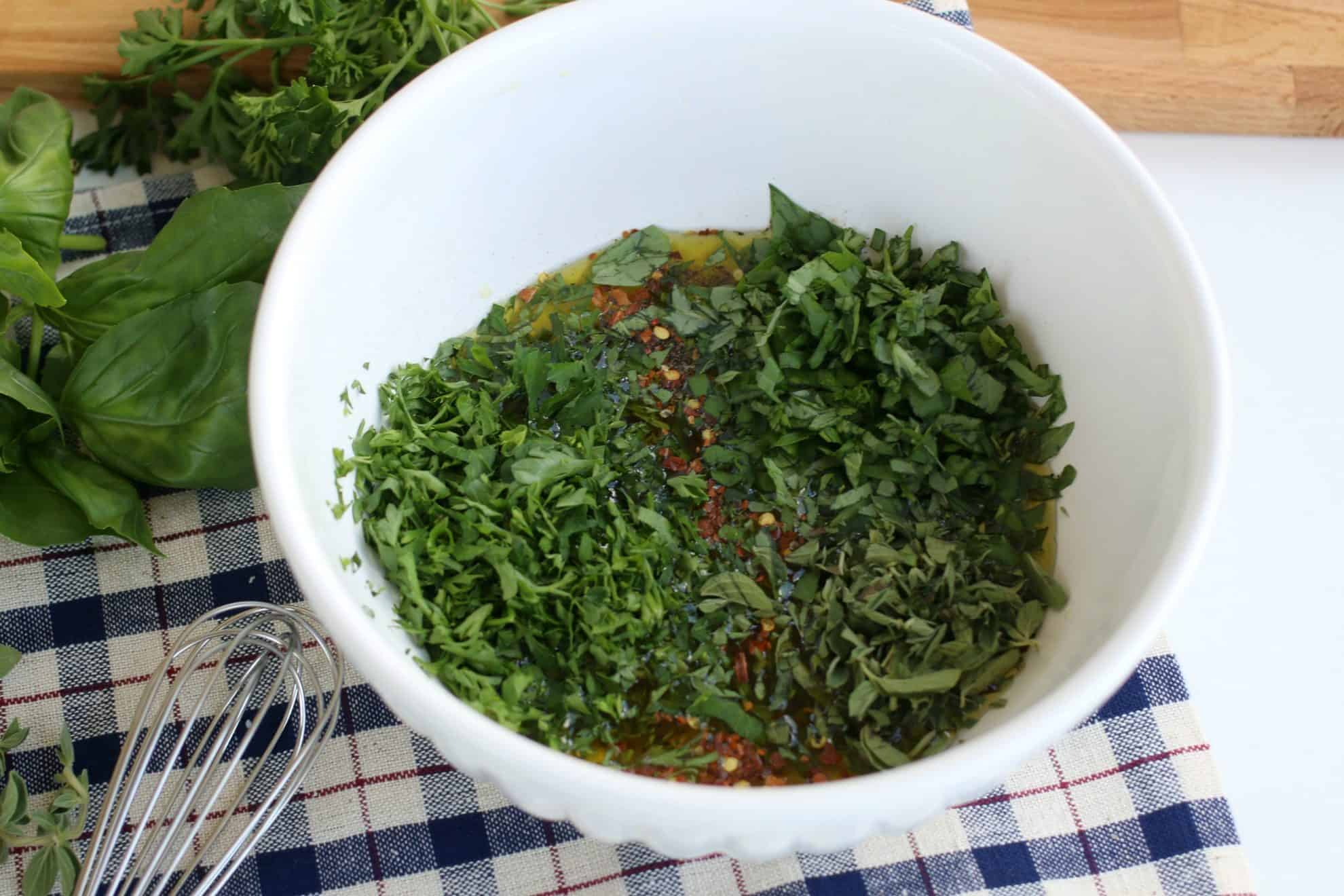 Add the cut up herbs to the bowl with all the rest of the ingredients for a simple marinade.